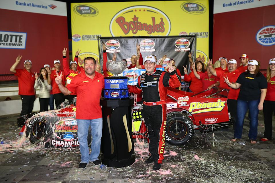 CHARLOTTE, NC - OCTOBER 08: Andy Seuss, driver of the #11 Northeast Race Cars/Ideal Finance Chevrolet, celebrates after winning the Championship for the NASCAR Whelen Southern Modified Tour at Charlotte Motor Speedway on October 8, 2015 in Charlotte, North Carolina. (Photo by Sarah Crabill/NASCAR via Getty Images) *** Local Caption *** Andy Seuss