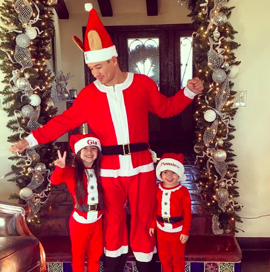 """<p>Mario Lopez really got into the Christmas spirit with his kids, Gia, 6, and Dominic, 3, on Christmas morning. The <i>Extra</i> host's wife Courtney dubbed the adorable trio """"Santa squad…"""" (Photo: <a rel=""""nofollow noopener"""" href=""""https://www.instagram.com/p/BOcvYq2A11g/"""" target=""""_blank"""" data-ylk=""""slk:Instagram"""" class=""""link rapid-noclick-resp"""">Instagram</a>) </p>"""