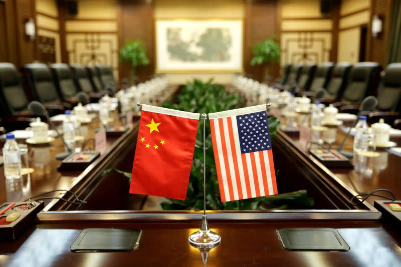 FILE PHOTO: Flags of U.S. and China are placed for a meeting at the Ministry of Agriculture in Beijing