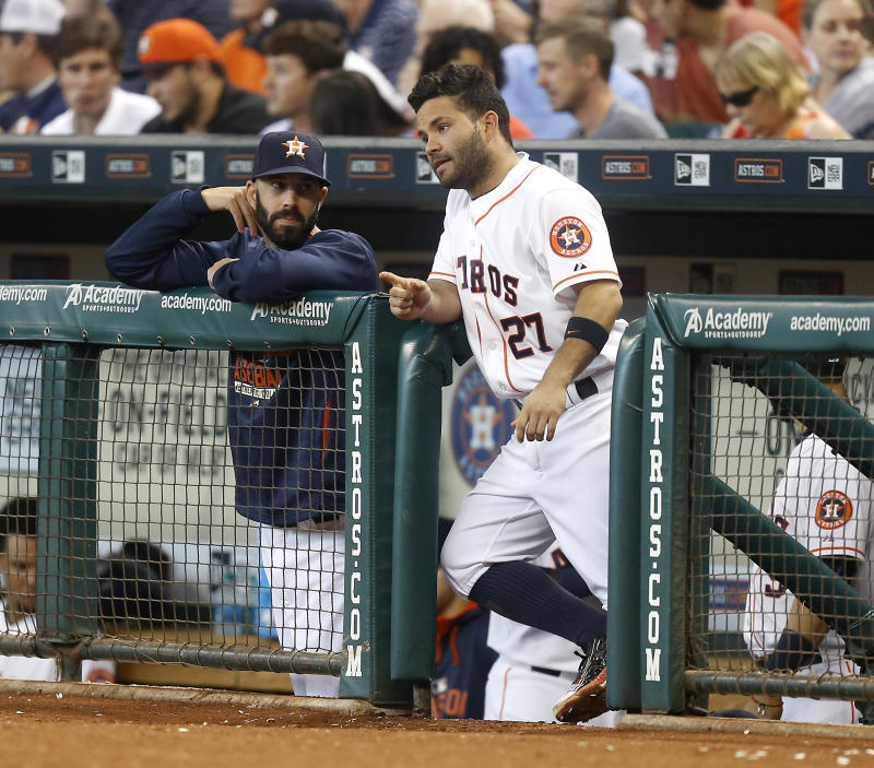HOUSTON, TX - AUGUST 22: Jose Altuve #27 of the Houston Astros and Mike Fiers #54 talk at Minute Maid Park on August 22, 2015 in Houston, Texas. (Photo by Bob Levey/Getty Images)