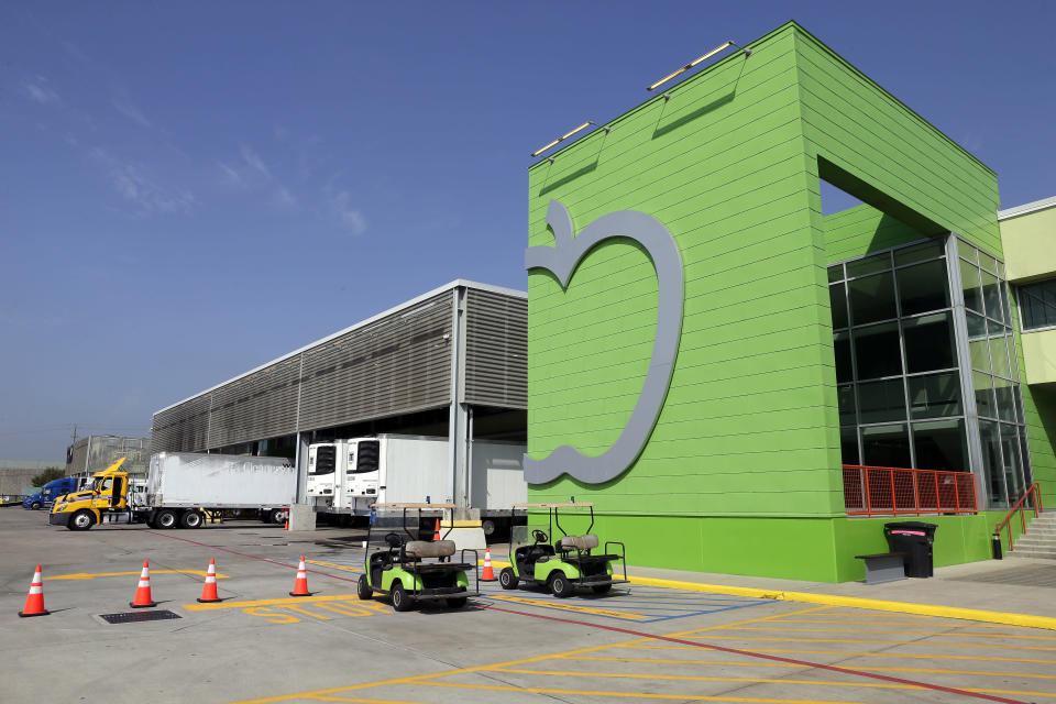 The main client entrance and loading docks of the Houston Food Bank are seen Wednesday, Oct. 14, 2020, in Houston. Distributions by the Houston Food Bank now average about 800,000 pounds (363,000 kilograms) daily after reaching the unprecedented 1 million pound mark for the first time in the spring, a level that the organization still delivers periodically. Before the coronavirus struck, the group's average daily distribution was 450,000 pounds (184,000 kilograms), said Houston Food Bank President Brian Greene. (AP Photo/Michael Wyke)