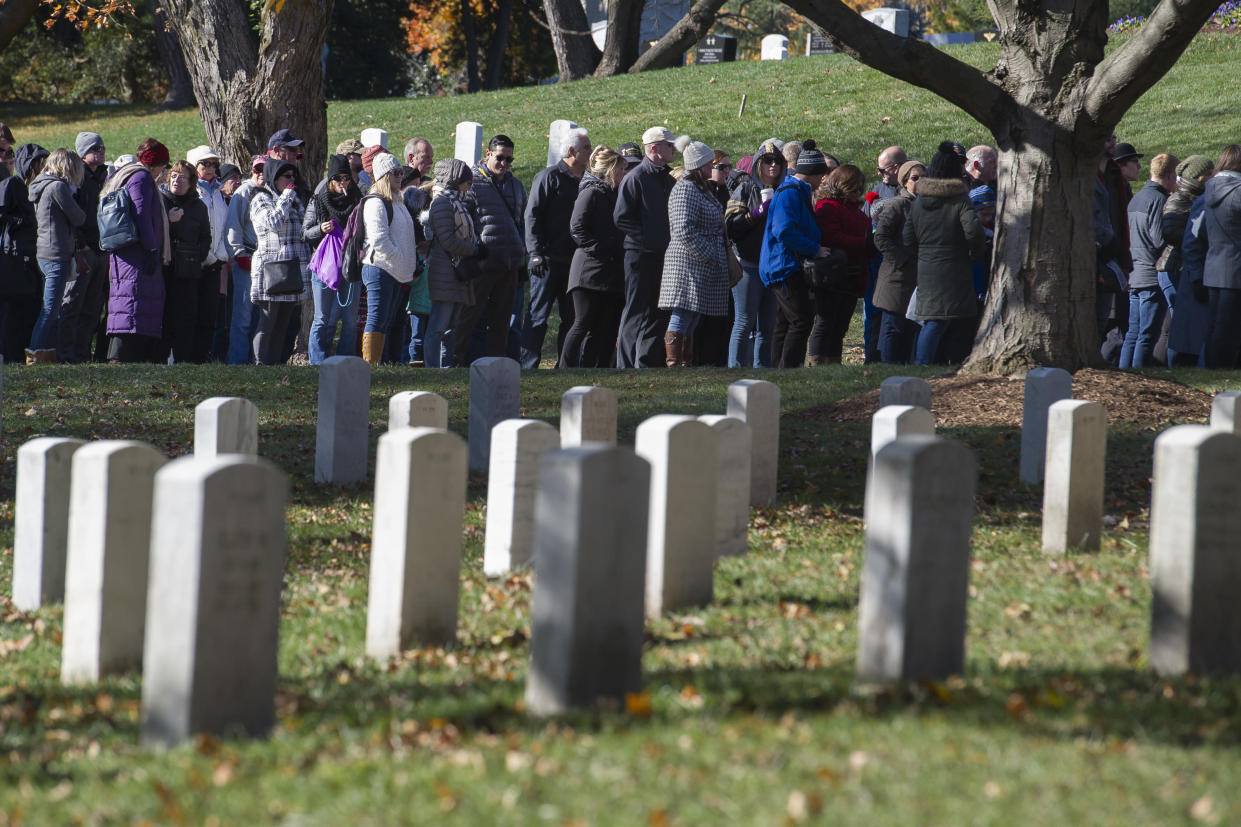People stand in line to enter the Arlington National Cemetery Amphitheater for the National Veterans Day Observance on Sunday. (Photo: Cliff Owen/AP)