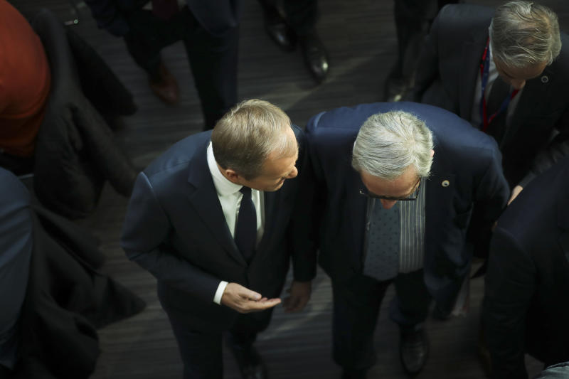 European Council President Donald Tusk, left, and European Commission President Jean-Claude Juncker speak with each other as they walk to a media conference at the conclusion of an EU summit in Brussels, Friday, March 22, 2019. European Union leaders gathered again Friday after deciding that the political crisis in Britain over Brexit poses too great a threat and that action is needed to protect the smooth running of the world's biggest trading bloc. (AP Photo/Francisco Seco)