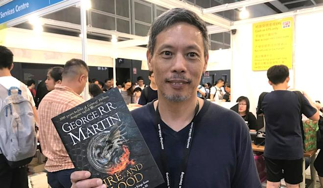 A fan brings home a copy of Fire and Blood by George R.R Martin, which was made available by Confidence Services Centre. Photo: Rachel Yeo