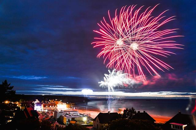<p>Fireworks in Arromanches-les-Bains seen from the M4A2 Sherman Tank Monument during D-Day Festival Normandy 2017. (Photo: Artur Widak/NurPhoto via Getty Images) </p>