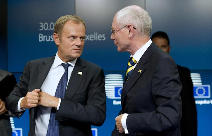 Polish Prime Minister and EU Council president-elect Donald Tusk (L) speaks with outgoing EU Council president Herman Van Rompuy at the end of a press briefing at EU Headquarters in Brussels on August 30, 2014 (AFP Photo/Alain Jocard)