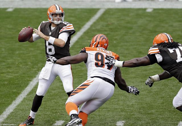 Cleveland Browns quarterback Brian Hoyer (6) sets to pass under pressure from Cincinnati Bengals defensive tackle Geno Atkins (97) in the second quarter of an NFL football game on Sunday, Sept. 29, 2013, in Cleveland. (AP Photo/Tony Dejak)