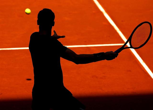 <p>Silhouette of Grigor Dimitrov of Bulgaria in action against P. Kohlschreiber of Germany at the Mutua Madrid Open, Madrid, Spain on May 8, 2017. Dimitirov won 7:6, 6:4. (Rex Shutterstock via ZUMA Press) </p>