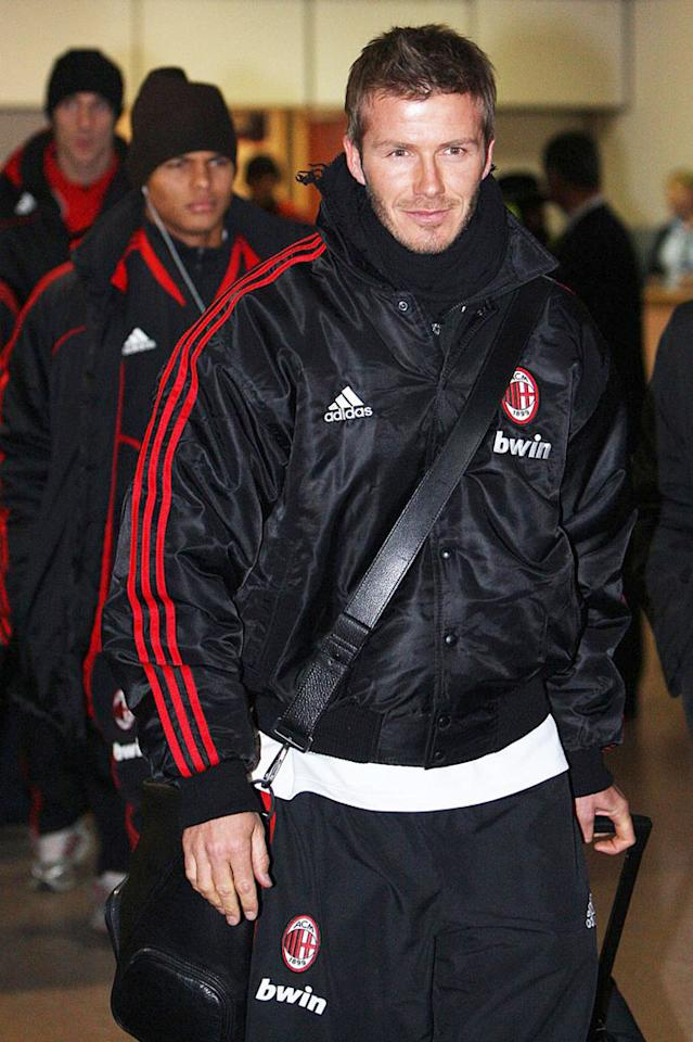 """David Beckham and his AC Milan teammates arrived in Glasgow, Scotland, last Wednesday. The soccer star, who's on loan from the LA Galaxy through March, has strongly hinted he wants to permanently transfer to the Italian club. Ian MacNicol/<a href=""""http://www.pacificcoastnews.com/"""" target=""""new"""">PacificCoastNews.com</a> - February 4, 2009"""