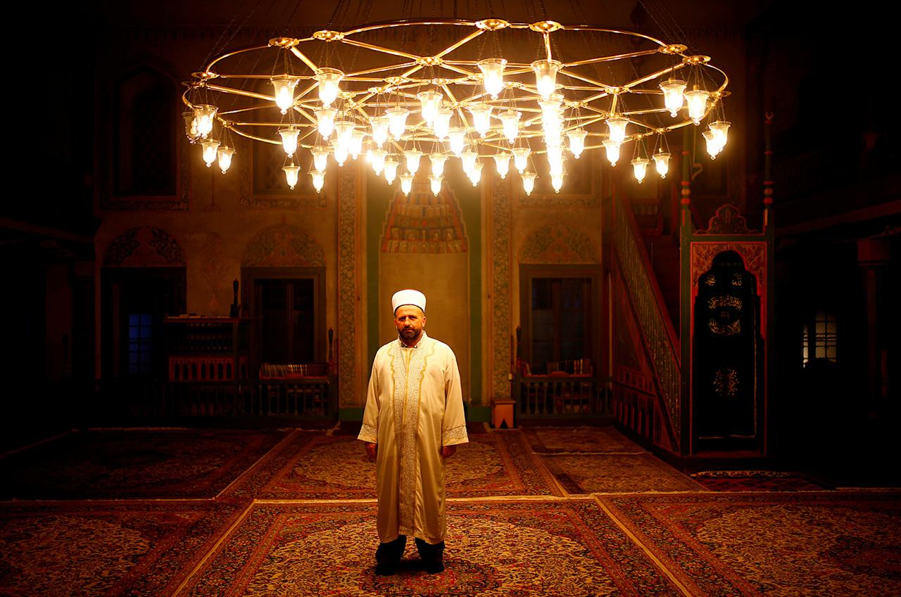 """<p>Effendi Ibranovic Dzemail poses for a photograph inside Sulejmanija Mosque in Travnik, Bosnia and Herzegovina, July 20, 2017. """"Sulejmanija Mosque in Travnik is famous because it has many different colors inside. You can compare that with different religions in Bosnia and Herzegovina. Bosnia is beautiful and colorful precisely because of its multiculturalism. That is the true value of this country, which we should preserve and nurture,"""" Dzemail said. (Photo: Dado Ruvic/Reuters) </p>"""