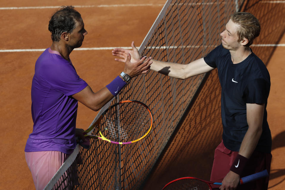 Spain's Rafael Nadal, left, shakes hands with Canada's Denis Shapovalov,at the end of their 3rd round match at the Italian Open tennis tournament, in Rome, Thursday, May 13, 2021. Nadal won 6-3, 4-6, 6-7. (AP Photo/Alessandra Tarantino)