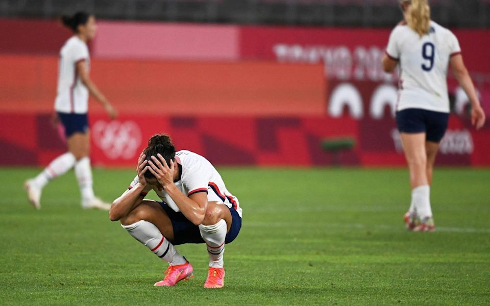 Carli Lloyd sinks down on her haunches at full time - GETTY IMAGES