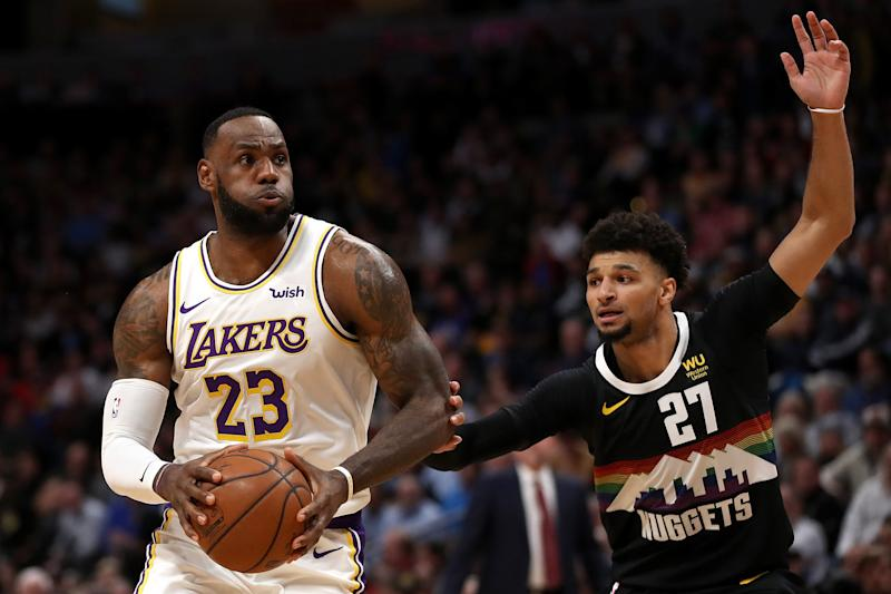 Nuggets guard Jamal Murray will have to keep pace with Lakers superstar LeBron James. (Matthew Stockman/Getty Images)