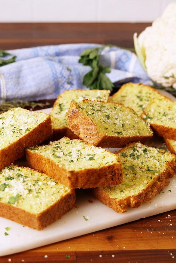"""<p>A guilt free and totally delicious savory bread.</p><p>Get the recipe from <a href=""""https://www.delish.com/cooking/recipe-ideas/recipes/a56226/cauliflower-garlic-bread-recipe/"""" rel=""""nofollow noopener"""" target=""""_blank"""" data-ylk=""""slk:Delish"""" class=""""link rapid-noclick-resp"""">Delish</a>. </p>"""