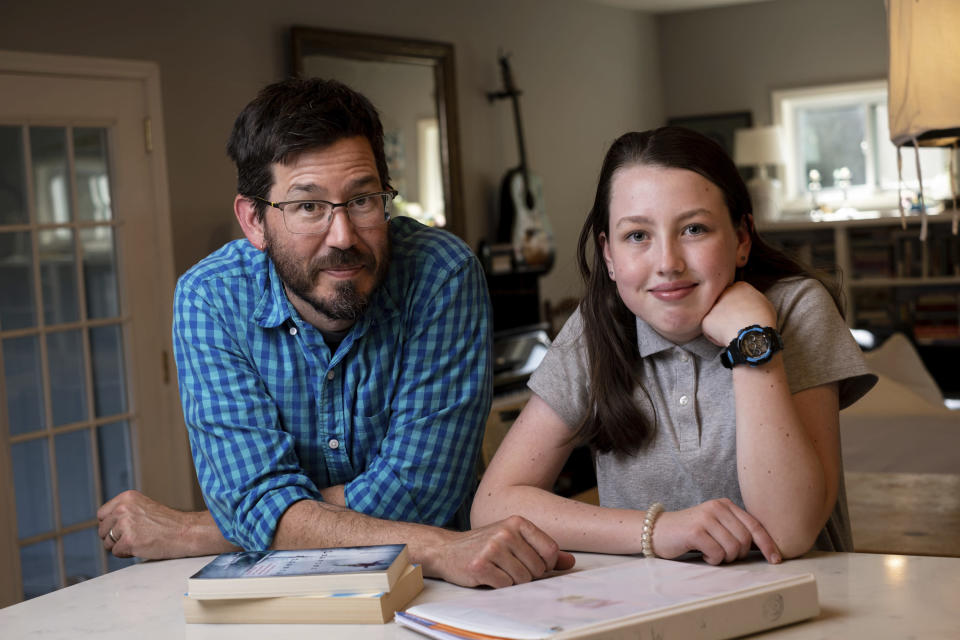 Jay Wamsted, left, and his daughter, Kira, are photographed on Thursday, May 20, 2021 in Smyrna, Ga. Wamsted, who is an 8th grade math teacher, allowed his daughter to skip testing this year. With new flexibility from the Biden administration, states are adopting a patchwork of testing plans that aim to curb the stress of exams while still capturing some data on student learning. (AP Photo/Ben Gray)