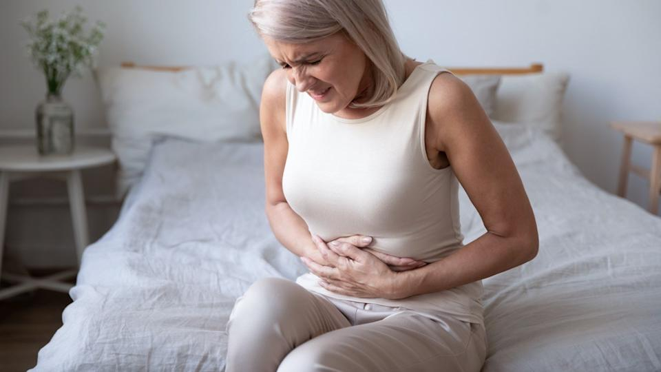 Woman with nausea upset stomach