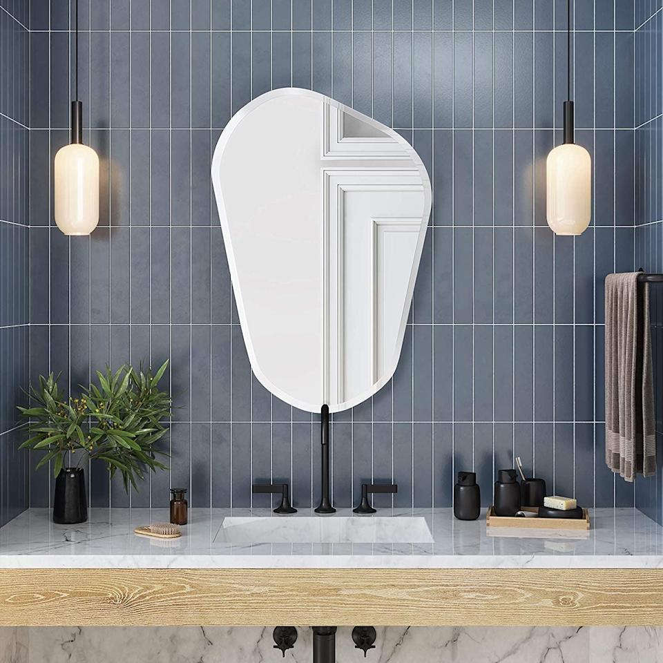 <p>Embellish your bathroom in one simple step by getting this <span>Better Bevel Frameless Asymmetrical Novelty Mirror</span> ($90).</p>