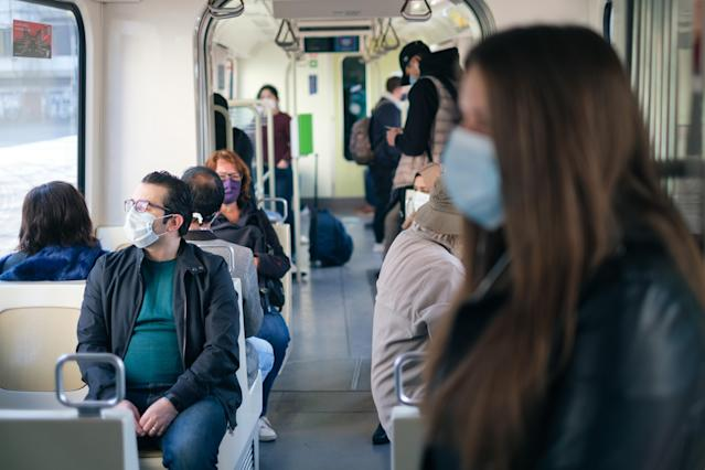 Passengers wear masks on a train in Hanover, Germany. (Getty Images)