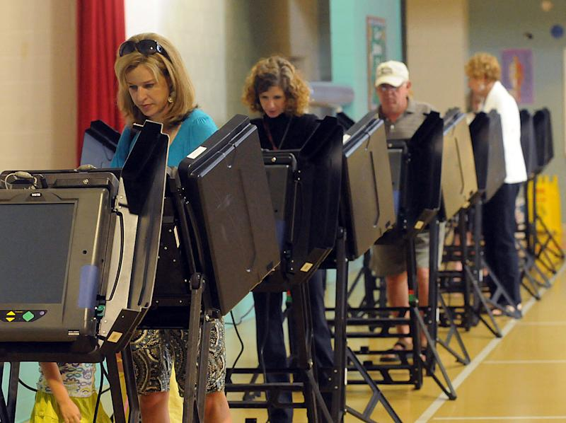 Gretchen Colby casts her vote Tuesday, May 8, 2012, at Belville Elementary School in Brunswick County, N.C. North Carolina could be the next state to pass a constitutional amendment defining marriage as solely between a man and a woman. Voters are casting their ballots Tuesday. (AP Photo/The Star-News, Ken Blevins)