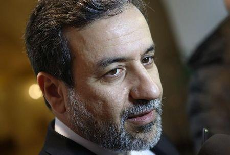 Iran's top nuclear negotiator Araqchi talks to journalists after meeting senior officials from the United States, Russia, China, Britain, Germany and France in a hotel in Vienna