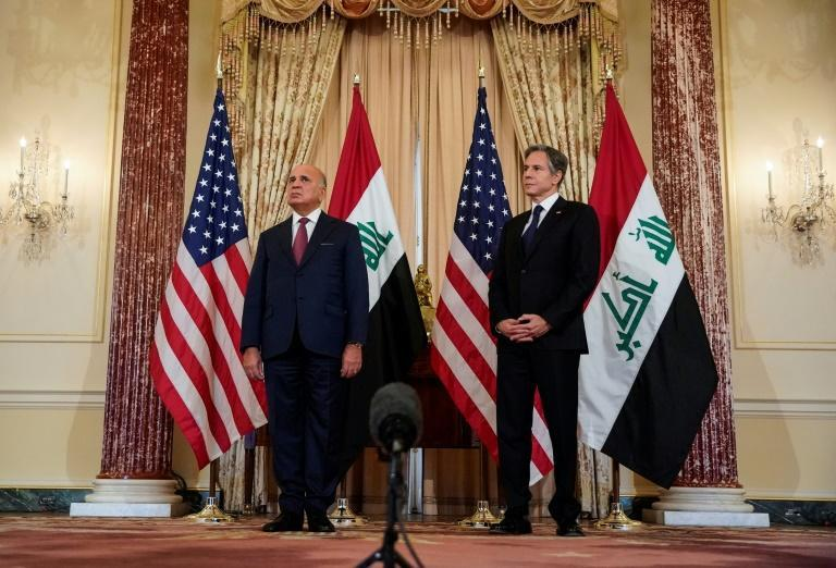 US Secretary of State Antony Blinken and Iraqi Foreign Minister Fuad Hussein speak to the press at the State Department