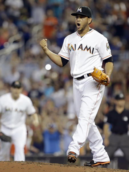 Miami Marlins' Henderson Alvarez celebrates after striking out Detroit Tigers' Matt Tuiasosopo for the last out of the ninth inning in an interleague baseball game on Sunday, Sept. 29, 2013, in Miami. Alvarez got a no-hitter as the Marlins won 1-0. (AP Photo/Alan Diaz)