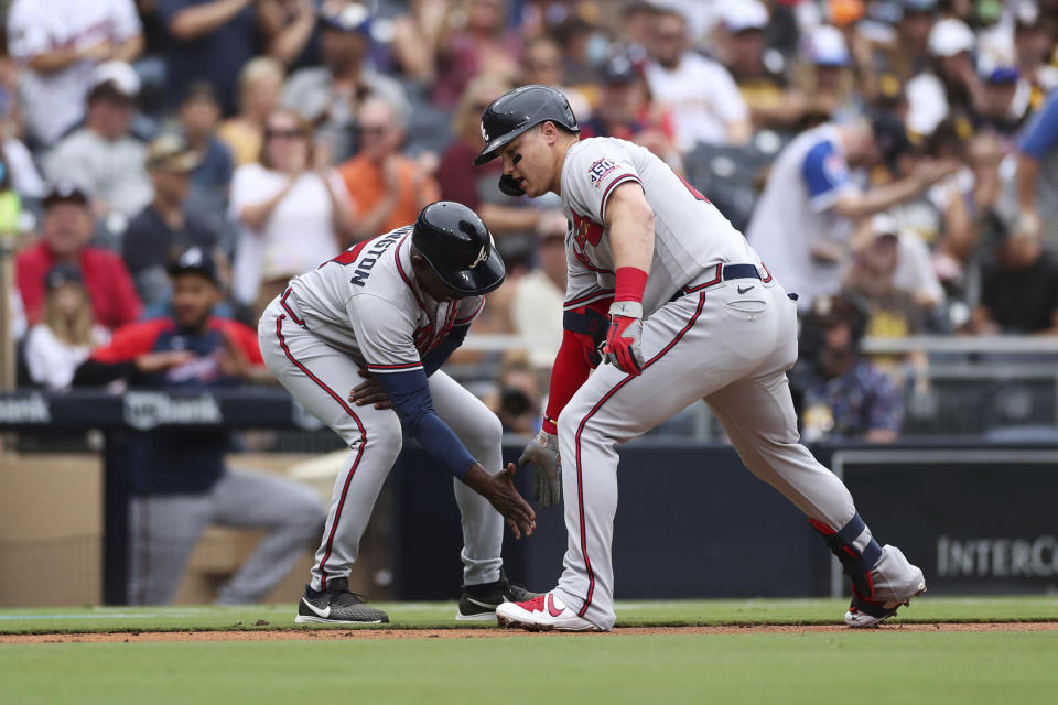 Atlanta Braves' Joc Pederson, right, is congratulated by third base coach Ron Washington as he rounds the bag after hitting a solo home run in the second inning of a baseball game against the San Diego Padres, Sunday, Sept. 26, 2021, in San Diego. (AP Photo/Derrick Tuskan)