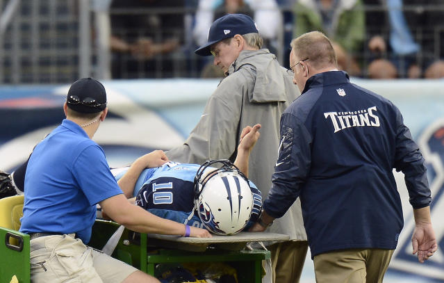 Tennessee Titans quarterback Jake Locker (10) gives a thumbs-up to the crowd as he is taken off the field after being injured in the third quarter of an NFL football game against the New York Jets on Sunday, Sept. 29, 2013, in Nashville, Tenn. (AP Photo/Mark Zaleski)