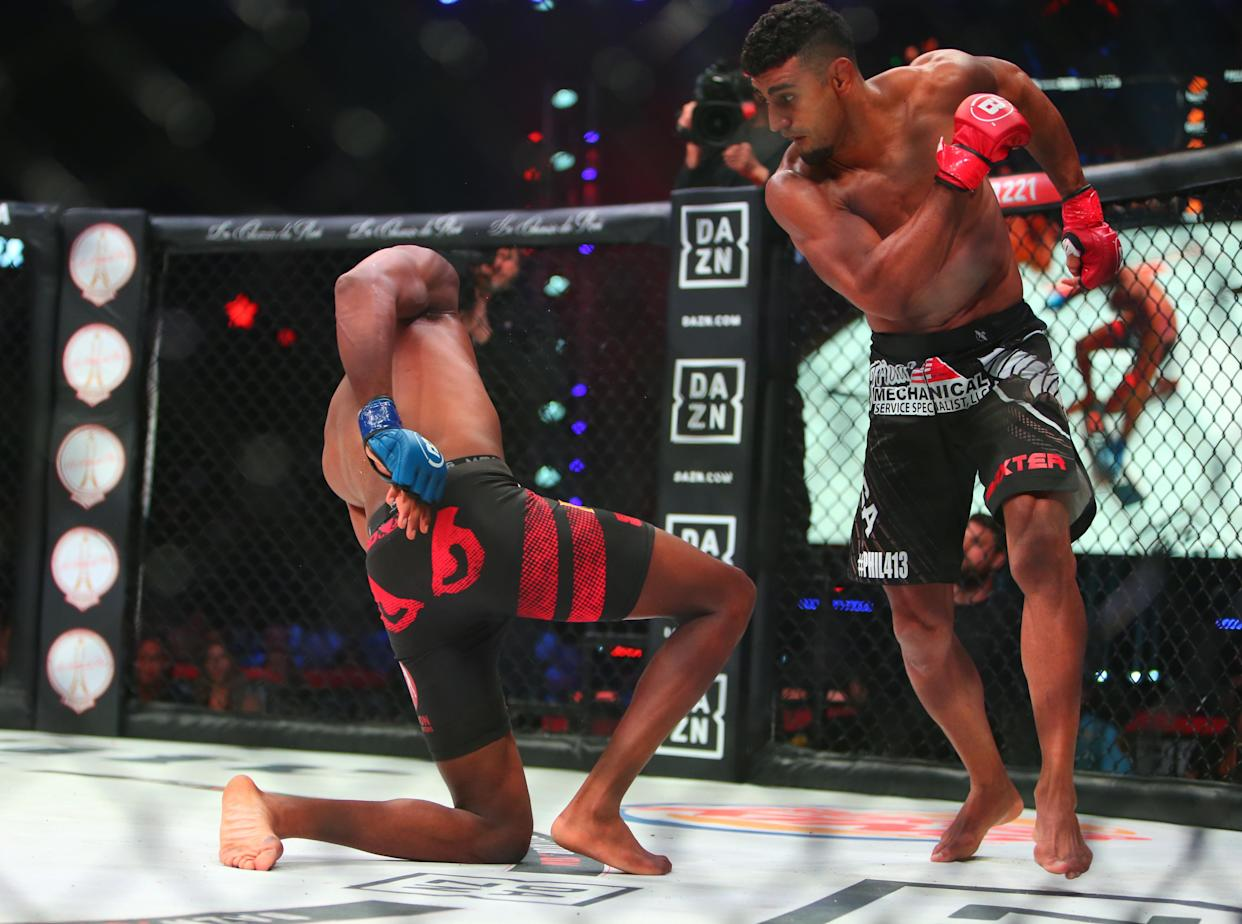 May 11, 2019; Rosemont, IL, USA;  Douglas Lima (red gloves) knocks out Michael Page (blue gloves) during Bellator 221 at Allstate Arena. Mandatory Credit: Jerry Lai-USA TODAY Sports