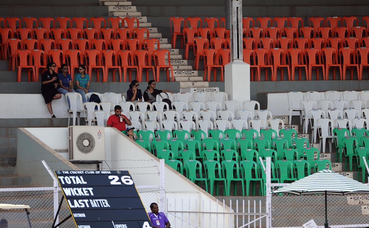 A handfull of Indian spectators sit in empty stands during the inugural match of the ICC Women's World Cup 2013 between India and West Indies at the Cricket Club of India's Brabourne stadium in Mumbai on January 31, 2013. Teams from Australia, England, New Zealand, Pakistan, South Africa, Sri Lanka, West Indies join hosts India for the global event which is being played from 31 January to 17 February.  The women's World Cup opened in Mumbai with the cricketers hoping to put aside memories of the unsavoury build-up and gain their due recognition in a country where the men's game reigns supreme. AFP PHOTO/ Indranil MUKHERJEE        (Photo credit should read INDRANIL MUKHERJEE/AFP/Getty Images)