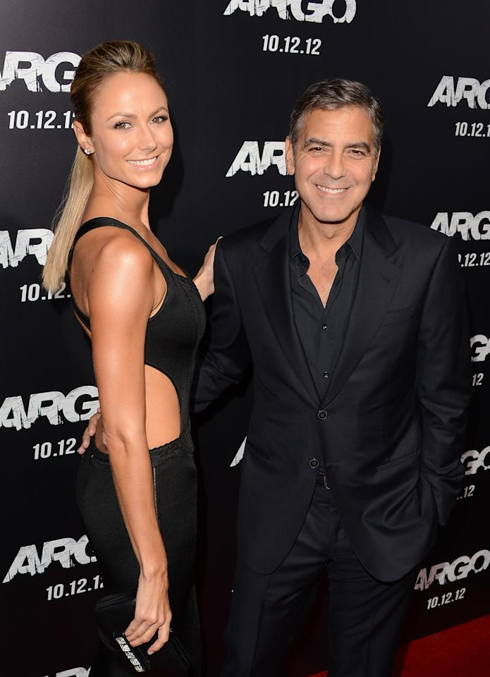 BEVERLY HILLS, CA - OCTOBER 04:  Actors Stacy Keibler and George Clooney arrive at the premiere of Warner Bros. Pictures' 'Argo' at AMPAS Samuel Goldwyn Theater on October 4, 2012 in Beverly Hills, California.  (Photo by Jason Merritt/Getty Images)