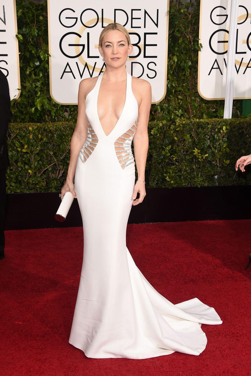 <p>The Hollywood icon made her presence known in this sexy Atelier Versace gown.</p>