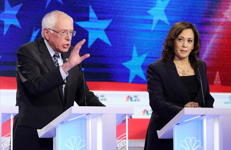 Democratic presidential candidates Sen. Bernie Sanders and Sen. Kamala Harris take part in the second night of the first Democratic presidential debate in June in Miami, Florida. (Photo: Drew Angerer via Getty Images)