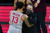 Minnesota head coach Richard Pitino hugs Ohio State guard CJ Walker (13) following an NCAA college basketball game against Ohio State at the Big Ten Conference tournament in Indianapolis, Thursday, March 11, 2021. Ohio State defeated Minnesota 79-75. (AP Photo/Michael Conroy)
