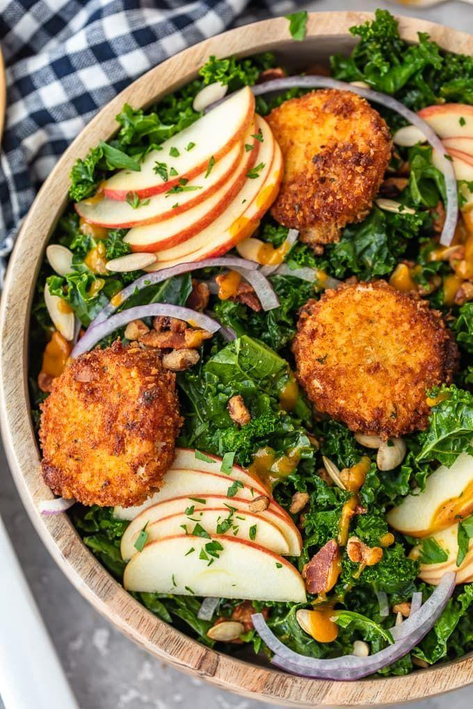 """<p>Fried goat cheese and maple pumpkin dressing? Um, yes, please! You'll want to make this salad for yourself long after Thanksgiving.</p><p><strong>Get the recipe at <a href=""""https://www.thecookierookie.com/kale-salad-recipe-fall-salad/"""" rel=""""nofollow noopener"""" target=""""_blank"""" data-ylk=""""slk:The Cookie Rookie"""" class=""""link rapid-noclick-resp"""">The Cookie Rookie</a>.</strong> </p>"""