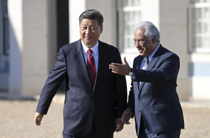 China's President Xi Jinping walks with Portuguese Prime Minister Antonio Costa, right, before their meeting Wednesday, Dec. 5, 2018, at the Queluz National Palace in Queluz, outside Lisbon. Xi closes Wednesday a two-day state visit to Portugal. (AP Photo/Armando Franca)