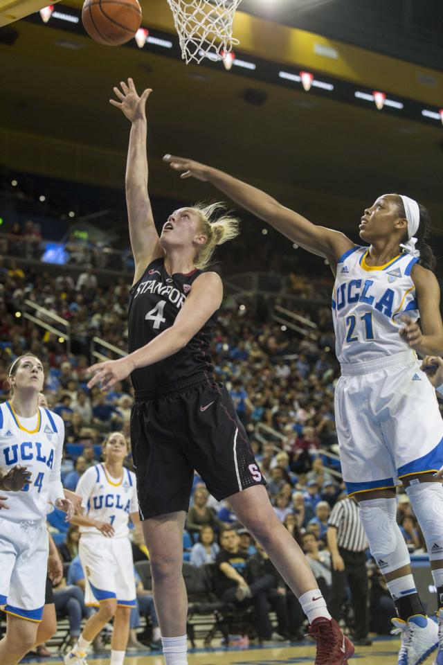 Stanford forward Taylor Greenfield, left, goes up for a lay-up against UCLA guard Nirra Fields, right, in the first half of an NCAA college basketball game, Sunday, Feb. 23, 2014 in Los Angeles. (AP Photo/Ringo H.W. Chiu)