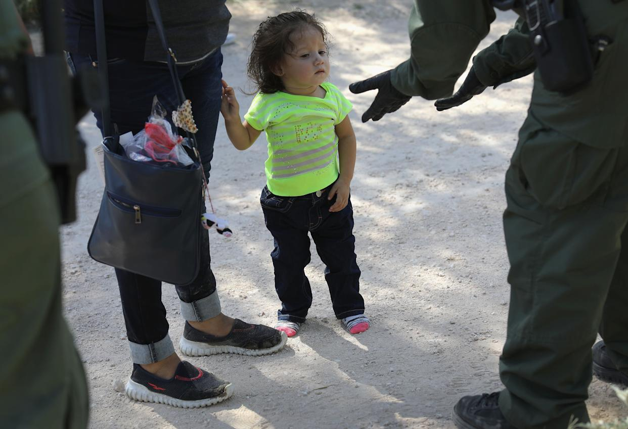 U.S. Border Patrol agents take a Central American family into custody on June 12, 2018 near McAllen, Texas.