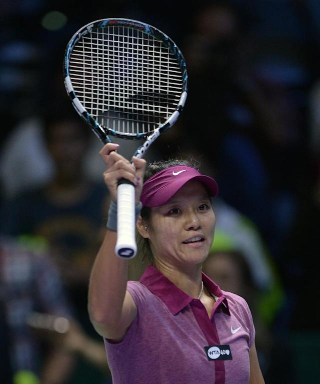 Li Na of China waves after defeating Sara Errani of Italy during their tennis match at the WTA championship in Istanbul, Turkey, Wednesday, Oct. 23, 2013. The world's top female tennis players compete in the championships which runs from Oct. 22 until Oct. 27.(AP Photo)