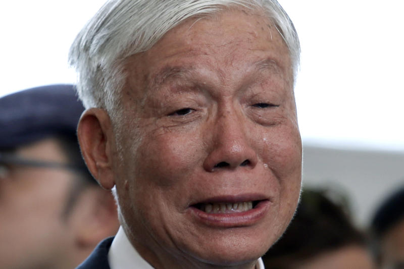 Occupy Central leader Chu Yiu-ming cries as he speaks to media after sentencing at a court in Hong Kong, Wednesday, April 24, 2019. A court in Hong Kong handed down prison sentences of up to 16 months Wednesday to eight leaders of massive 2014 pro-democracy protests on charges of public nuisance offenses. (AP Photo/Kin Cheung)