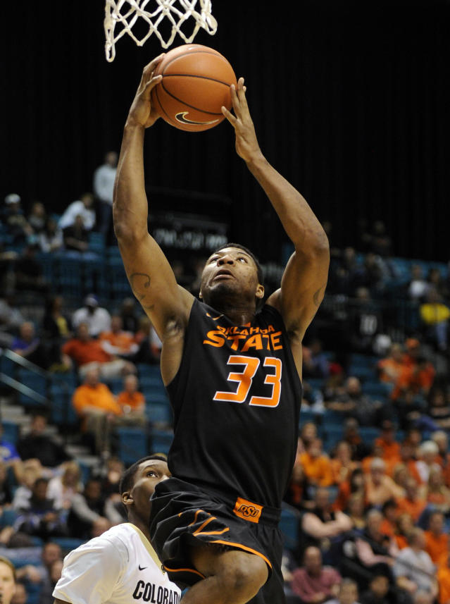 Oklahoma State's Marcus Smart shoots against Colorado during the second half of an NCAA college basketball game on Saturday, Dec. 21, 2013, in Las Vegas. Oklahoma State won 78-73. (AP Photo/David Becker)