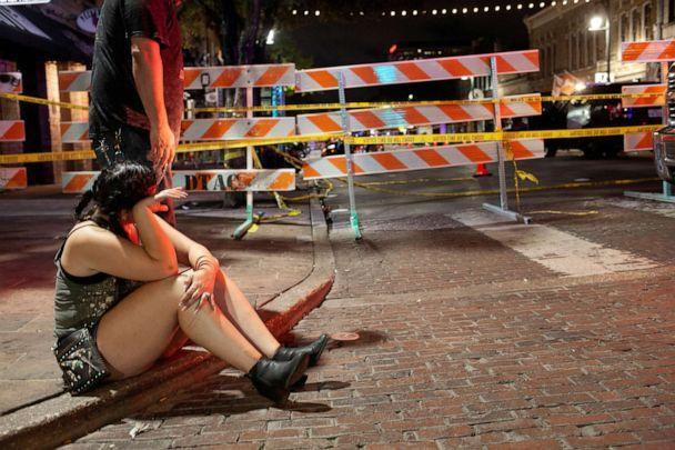 PHOTO: Angela Hicks waits for police to finish investigating the scene of a mass shooting on Sixth Street in the entertainment district of Austin, Texas, June 12, 2021.   (Nuri Vallbona/Reuters)