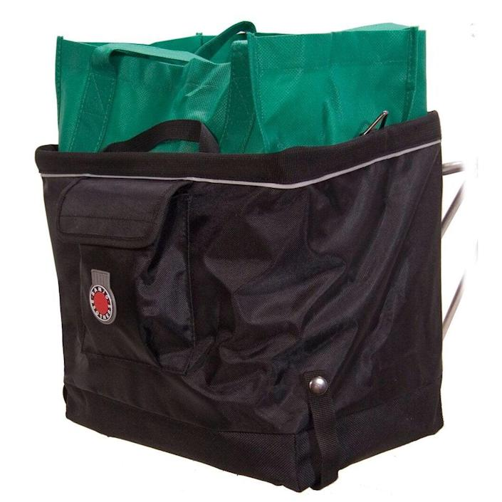 """<h3>Banjo Brothers Grocery Bag<br></h3> <br>If you're hauling a larger load, a pannier-style bag that hangs from your rear wheels is a safer option. (A too-heavily-loaded front basket will throw off your equilibrium.) This glowingly-reviewed bag has a ripstop nylon construction and a folding design, allowing it to flatten when empty and hold a <em>lot</em> when open. (You will need a rear rack — which your local bike shop can easily install — for any bag like this.) <br><br>Bonus: this super-popular carryall was sold out for a minute, but just restocked. Run, don't walk. (Or, actually, bike.)<br><br><strong>Banjo Brothers</strong> Banjo Brothers Grocery Bag Pannier, $, available at <a href=""""https://www.amazon.com/Banjo-Brothers-01080BAN-Grocery-Pannier/dp/B003D4EYL6/ref=pd_bxgy_img_3/139-8559127-4122734"""" rel=""""nofollow noopener"""" target=""""_blank"""" data-ylk=""""slk:Amazon"""" class=""""link rapid-noclick-resp"""">Amazon</a><br><br><br>"""