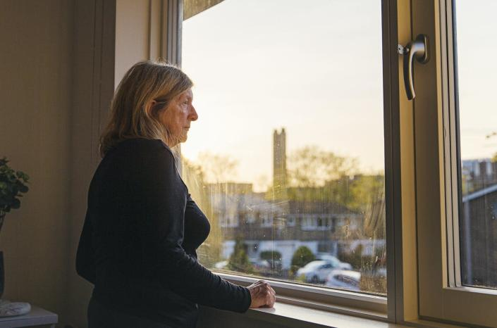 """<span class=""""caption"""">In healthy older people, loneliness has a pattern of stress response similar to that of people who are under chronic stress. </span> <span class=""""attribution""""><a class=""""link rapid-noclick-resp"""" href=""""https://www.gettyimages.com/detail/photo/senior-woman-looking-out-of-her-bedroom-window-at-royalty-free-image/1218053691"""" rel=""""nofollow noopener"""" target=""""_blank"""" data-ylk=""""slk:Justin Paget via Getty Images"""">Justin Paget via Getty Images</a></span>"""