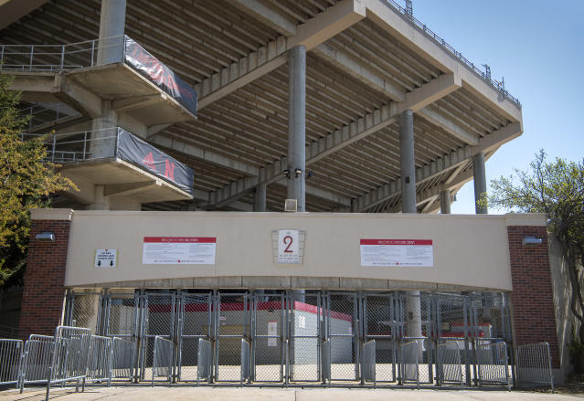 FILE - In this Saturday, April 18, 2020, file photo, Gate 2 at Memorial Stadium is empty because the annual Red-White matchup was cancelled due to the coronavirus pandemic. The goal is for all of major college football _ 130 teams in 10 conferences across 41 states _ to start a season at the same time and play an equal number of games. It is becoming more apparent the coronavirus pandemic is going to make that goal difficult to achieve. (Francis Gardler/Lincoln Journal Star via AP, File)