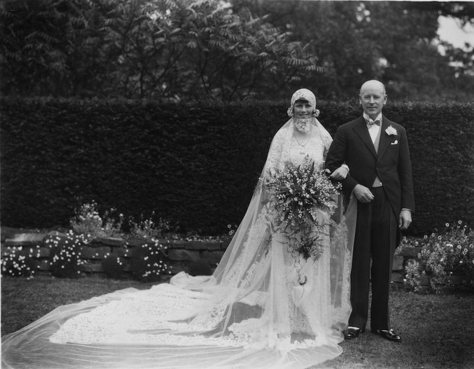<p>A fabulous bouquet is the finishing touch to this lavish lace dress worn by socialite Janet Morton on her wedding day. We just wish we could see what that garden looked like, in color.</p>
