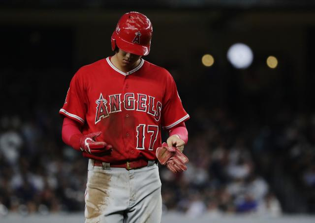 Los Angeles Angels' Shohei Ohtani walks to the dugout during the fourth inning of the team's baseball game against the New York Yankees on Friday, May 25, 2018, in New York. (AP Photo/Frank Franklin II)