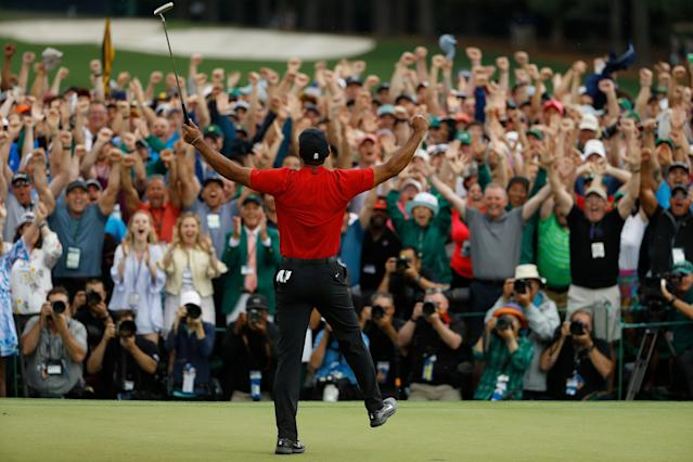 Eighteenth-green celebrations are great whether there are 10,000 people in attendance or zero. (AP)