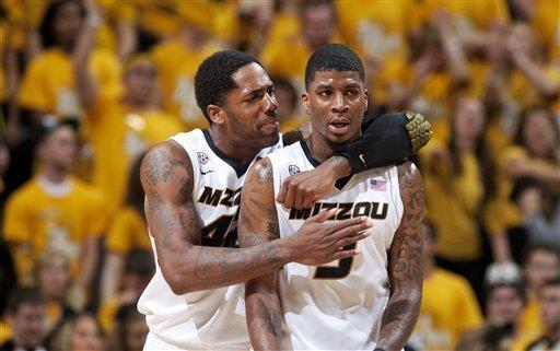 Missouri's Alex Oriakhi, left, grabs teammate Tony Criswell, right, during the first half of an NCAA college basketball game against Vanderbilt Saturday, Jan. 26, 2013, in Columbia, Mo. Missouri won the game 81-59. (AP Photo/L.G. Patterson)