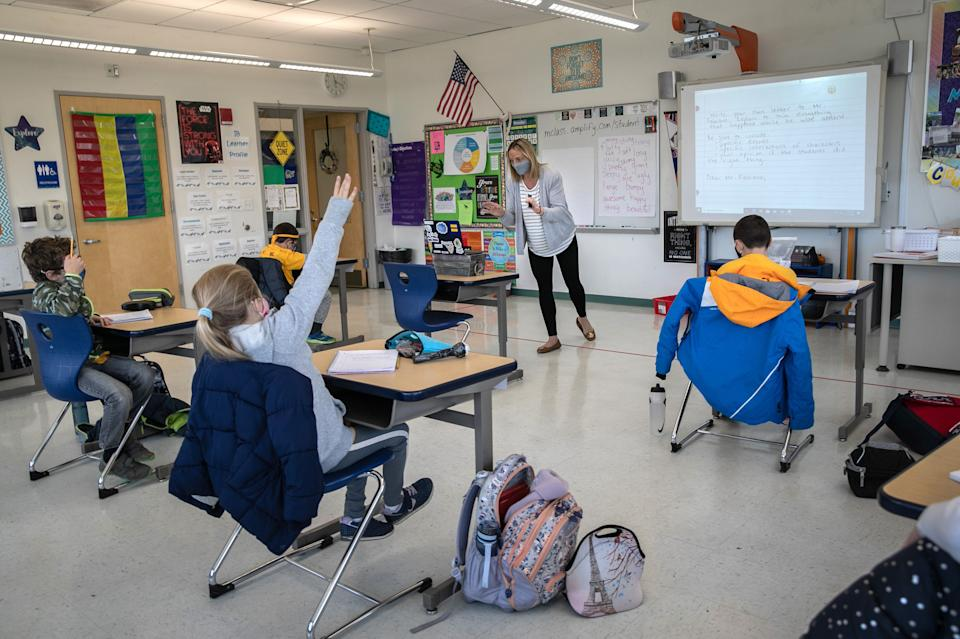 Third grade teacher Cara Denison speaks to students in November while live-streaming her class via Google Meet at Rogers International School in Stamford, Connecticut. (Photo: John Moore via Getty Images)